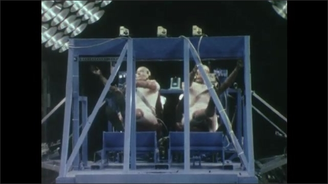 1980s: UNITED STATES: slow motion of crash test dummies in car crash. Destruction of vehicles during test