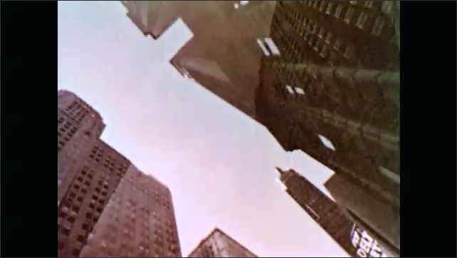 1960s: UNITED STATES: view of buildings from below. Tall buildings in city. Buildings made from concrete and glass. Skyscrapers in city