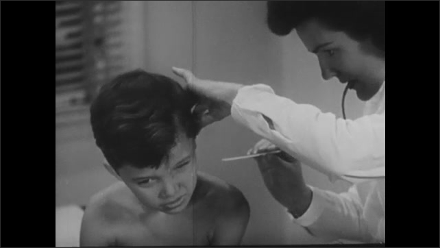 1940s: Nurse pricks boy's ear with lancet. Nurse removes blood from ear with glass tube.