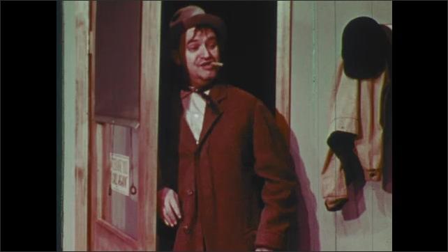 1960s: Man opens door, peeks into diner. Boy stands by machine. Man and boy talk.
