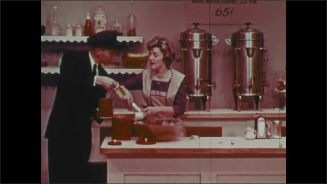 1960s: Man sits at counter, stares at jewelry on counter. Woman ties apron, starts mixing. Man and boy bring woman ingredients.
