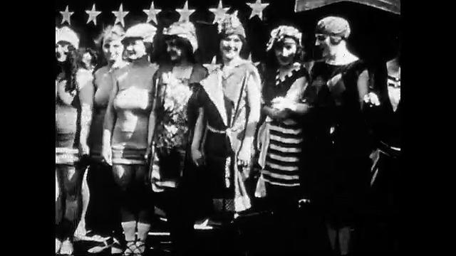 1920s: Women stand side by side, waving. Women sit in rows.