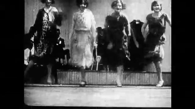 1920s: Four women dancing on stage. Woman dances with band on stage. Woman dance in unison under balloons.