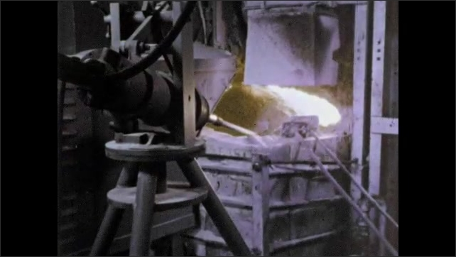 1960s: Conveyor belt dumps white powder into compartments on conveyor belt below. Large machine operates as powder is dumped into it.