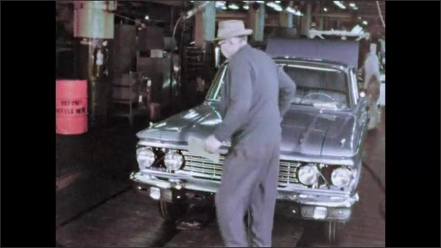 1960s: Men attaching hood to car frame. Man places seat in car. Man closes hood of car, opens hood.