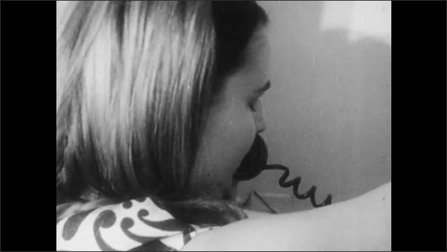 1960s: Boy runs out door, woman looks through door. Hand picks up phone. Boy runs down street. Woman talks on phone. Boy walks down street. Movie theater marquee. Boy walks to box office.