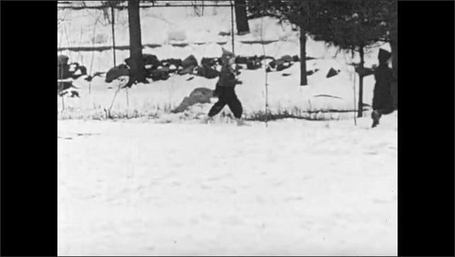 1940s: Children march through snow.
