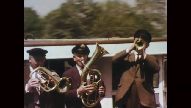 1970s: Men play instruments on ferry