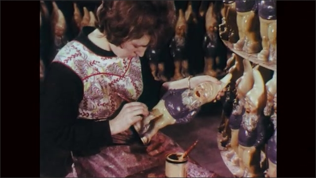 1970s: Gnomes in street. Person decorates gnomes. Gnomes on production line