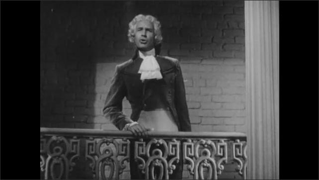 1940s: Man speaks from balcony.