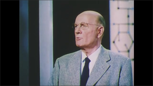 1960s: UNITED STATES: stunted plants after genetic exposure to radiation. Man ins studio talks to people on wall. World War Two use of radiation.