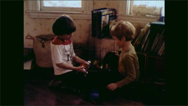 1970s: UNITED STATES: children play with toys. Imaginary play in childhood.