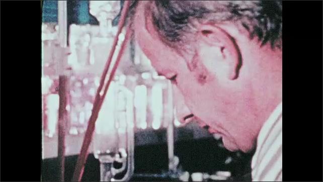 1960s: Men perform scientific research.