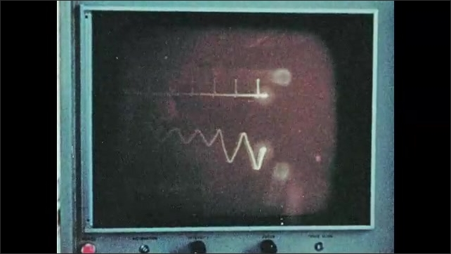 1960s: Large centrifuge spins around. Man monitors men inside centrifuge. Women work in laboratory. Man welds.