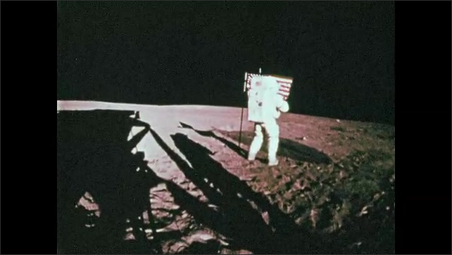 1960s: Astronauts set up flag on surface of moon.