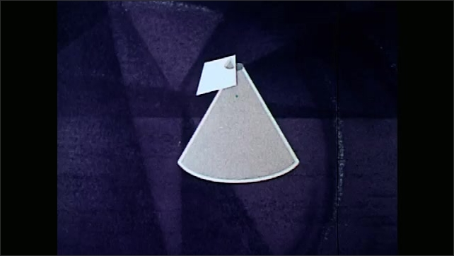 1970s: Circle and triangle spin.  Cone appears.  Cone turns into gears.  Cone is sliced.  Universe.