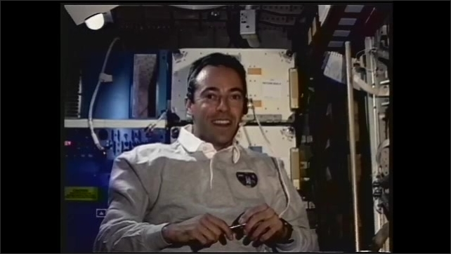 1990s: UNITED STATES: French astronaut talks to camera.