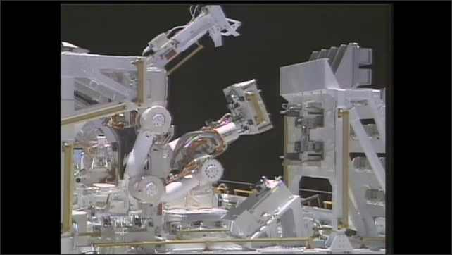 1990s: UNITED STATES: small arm used to replace modular device. Orbital Replacement Units (ORU's). Deployment of satellite using robotic arm.