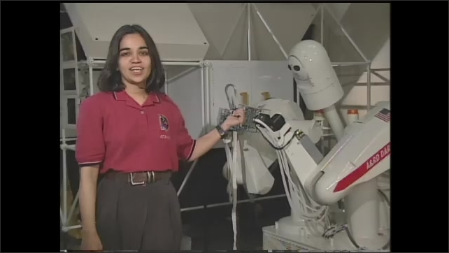 1990s: UNITED STATES: robot in robotic architecture lab. Lady speaks to camera. DART robot.