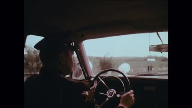 1970s: Man fills up gas tank, looks around. Farmer stands by tractor. Police officer drives car. Man looks up at sky, Radar dish rotates on tower. Man monitors radar screen.