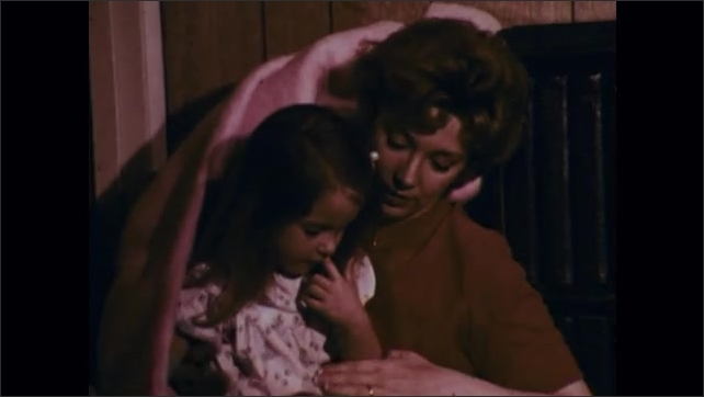 1970s: Trailer park and debris. Man opens doors of storm cellar and looks out. Woman and child come out from under blanket. Schoolchildren get up from floor. Policeman helps people out of ditch.