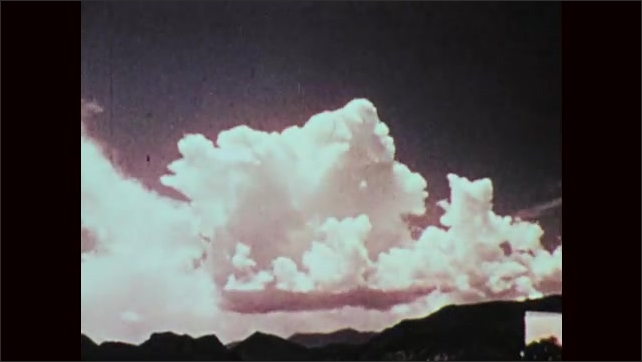 1970s: Clouds go by in sky, changing shape, disappearing and reforming and eventually taking up most of the sky.