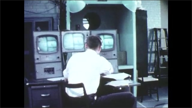 1960s: UNITED STATES: man works in front of television. Presenter demonstrates equipment on television