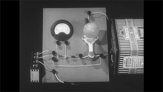 1940s: UNITED STATES: transistor switching circuit. Finger points at transistor