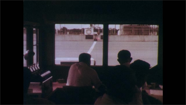 1960s: UNITED STATES: observers watch cars on track. Mobile timing unit. Speed trials on cars. Machine logs car speed on track