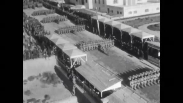 1960s: TURKEY: EUROPE: View across Port of Smyrna. Soldiers march in rows in street. Turkish war with Greeks.