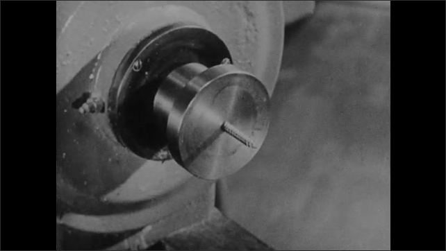 1940s: Close up, hand filing hollow object on plate. Close up of screw hole. View of woodworking plate. Hands attach piece of wood to plate.