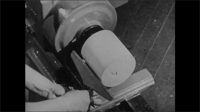 1940s: Hand attaches block of wood to lathe. Hands turn on machine, smoothe wood on lathe.