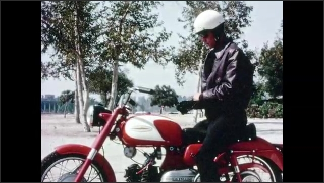 1960s: Close up, man putting on helmet. Man on motorcycle, puts on gloves, pulls away.