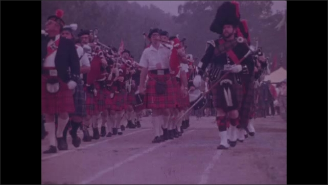 1970s: Sign for Mildred the Bear. Black bear in meadow. Deer and fawn browse meadow. Marching band in kilts march at Scottish Highland Games. Bagpiper looks up to sky. Three old men look and point.