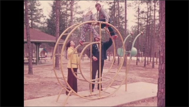 1970s: UNITED STATES: children climb on frame at park. Child stares into space at school. Child struggles to concentrate in class.