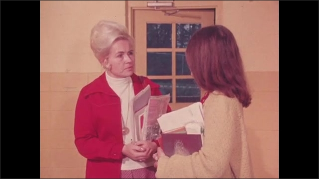 1970s: UNITED STATES: ladies talk in corridor. Child stares into space. Lady talks to students in class