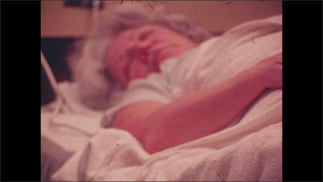 1970s: UNITED STATES: men push coffin at funeral. Patient in bed. Lady dies in bed.