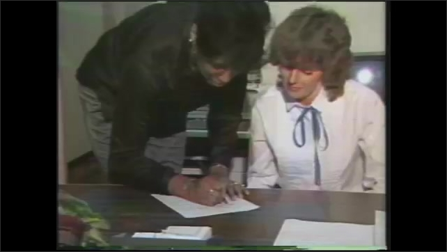 1980s: person coming to supervisor sitting at desk and filling out form to receive password for login