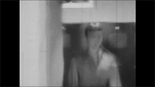 1950s: Teacher stands in classroom and thinks to self. Flashback visual. Teacher stands in doorway of classroom and thinks to self.