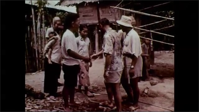 1960s: UNITED STATES: arrival of medical supplies at remote village clinic. Man arrives at clinic in remote location.