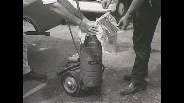 1960s: UNITED STATES: linseed oil emulsion poured from can to container. Men pour linseed oil into container. Linseed oil emulsion in labeled can.