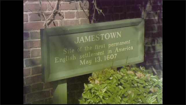 1970s: UNITED STATES: sign for Jamestown church site. English settlement in America 1607. Man stands by church railings. Portrait of early settlers.