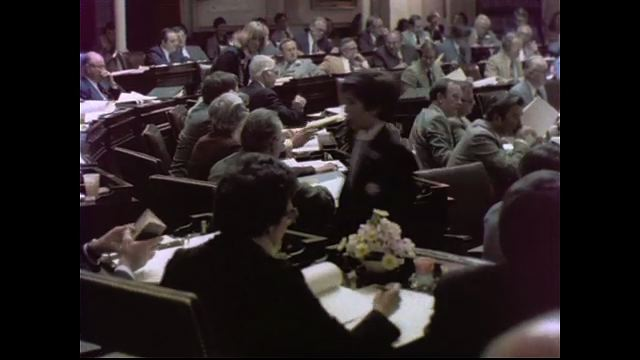 1970s: UNITED STATES: members sit in meeting. Man walks along rural path. Man walks by church. View through church yard