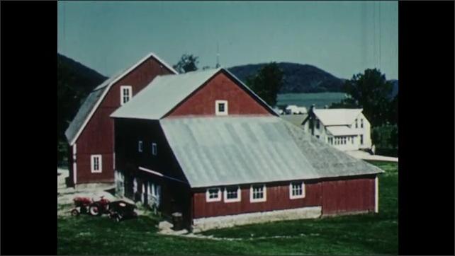 1950s: Farmhouse and barn. Woman walks down driveway.