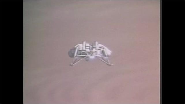 1970s: Tracking shot across control room. Spacecraft descending.