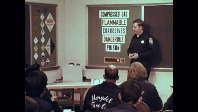 1970s: Vertical list of words: poison, dangerous, corrosive, flammable, compressed gas. List of danger signs. Man in uniform stands in front of class of adults, talking.