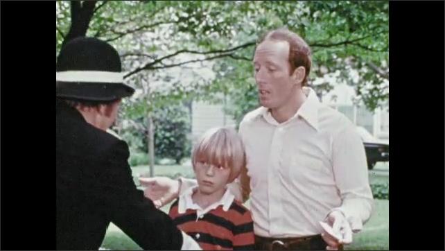 1970s: Man in hat speaks. Man speaks.