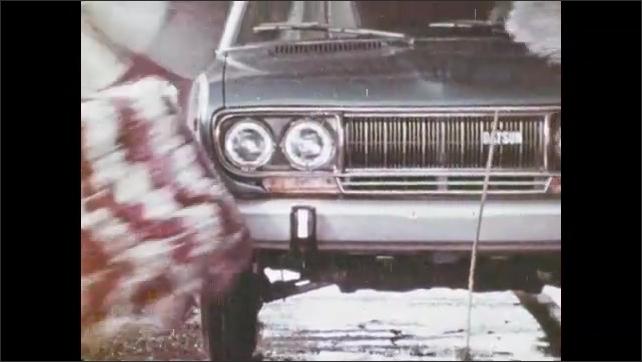 1970s: Woman drives down road.  Car goes through car wash.  Woman checks tire pressure.