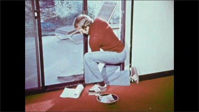 1970s: Man places cans on high shelf. Man slides glass door. Man places paper onto door.