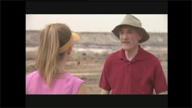 1990s: Man hands girl fossils. Girl looks at fossils, talks to man.
